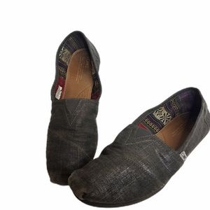 Gray Shimmering Slip On Toms.         012